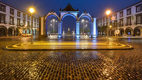 Ponta Delgada city gate at night, Azores, Portugal
