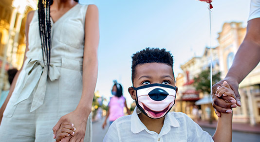 Boy wearing mask at Disneyland