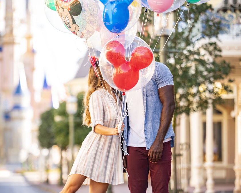 Couple holding balloons