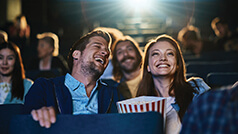 Couple enjoying movie in theatre