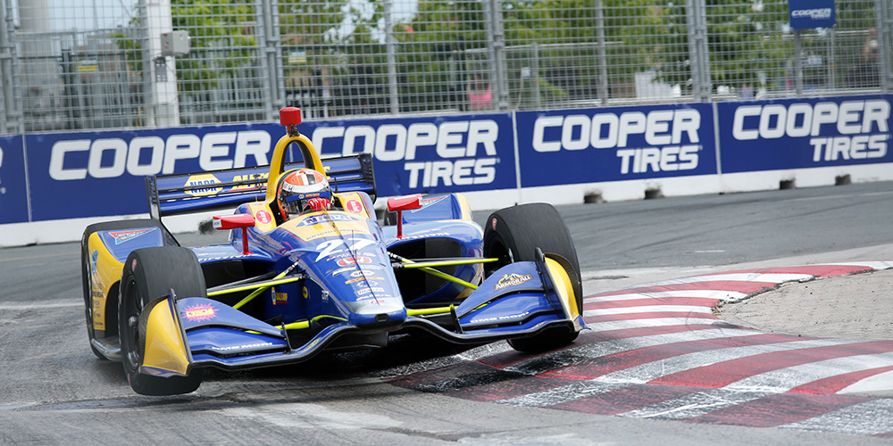 A race car speeds around the track at the Honda Indy Toronto.