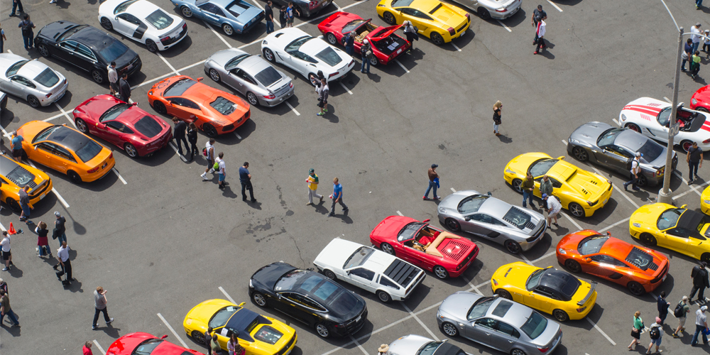 Rows of cars and spectators at auto show