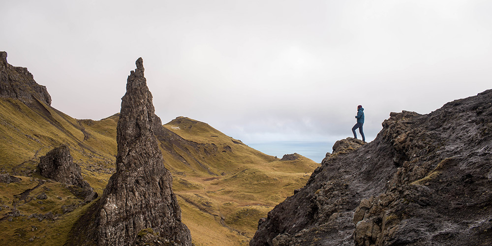 Hiking along the craggy rocks in Portree, Scotland