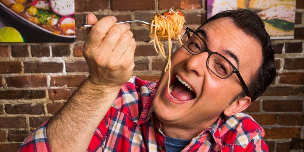 Food Network host John Catucci eating spaghetti