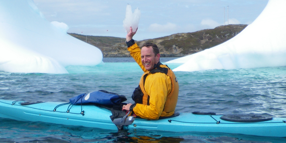 Robin Esrock kayaking with icebergs