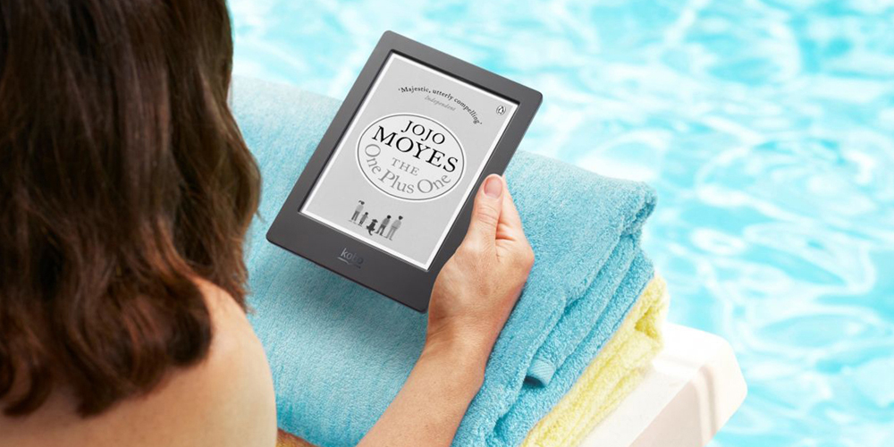 Woman reading e-reader by the pool