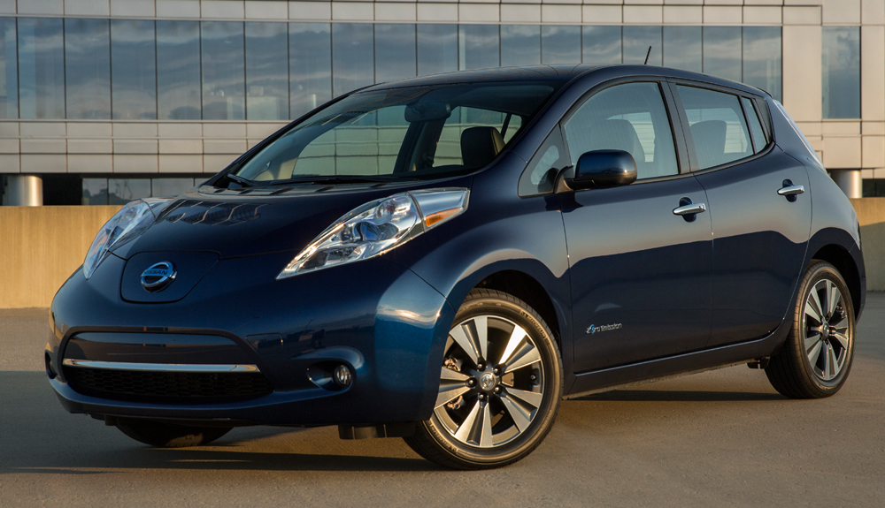 A dark blue Nissan Leaf