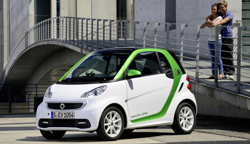 A white and green Smart fortwo